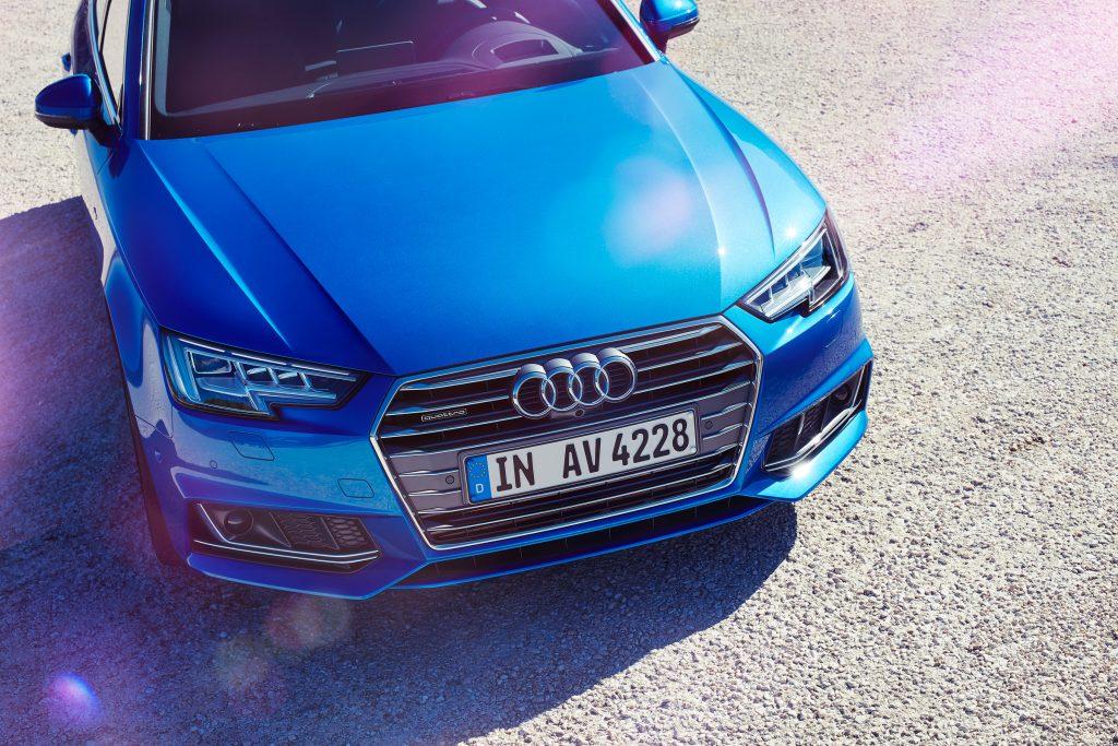 blue Audi car photo by Todd Antony