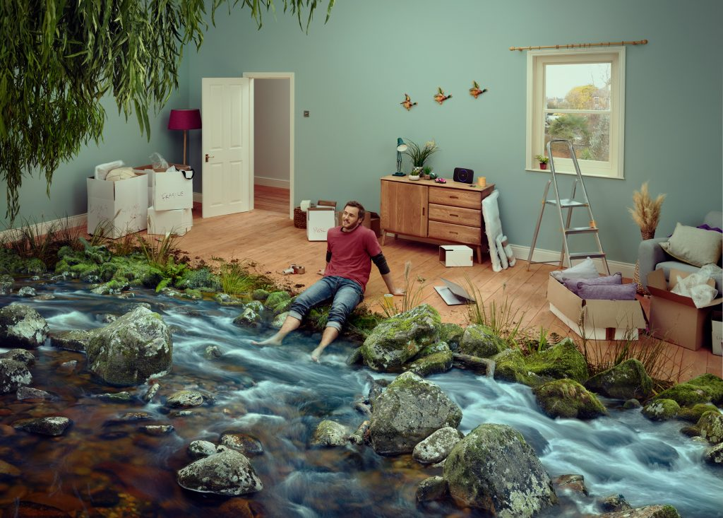 conceptual photograph of a river running through a persons lounge photo by Todd Antony