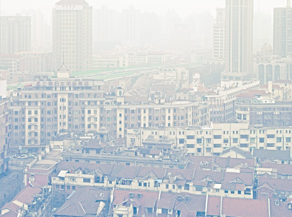 buildings in Shanghai covered in fog and smog photo by Todd Antony