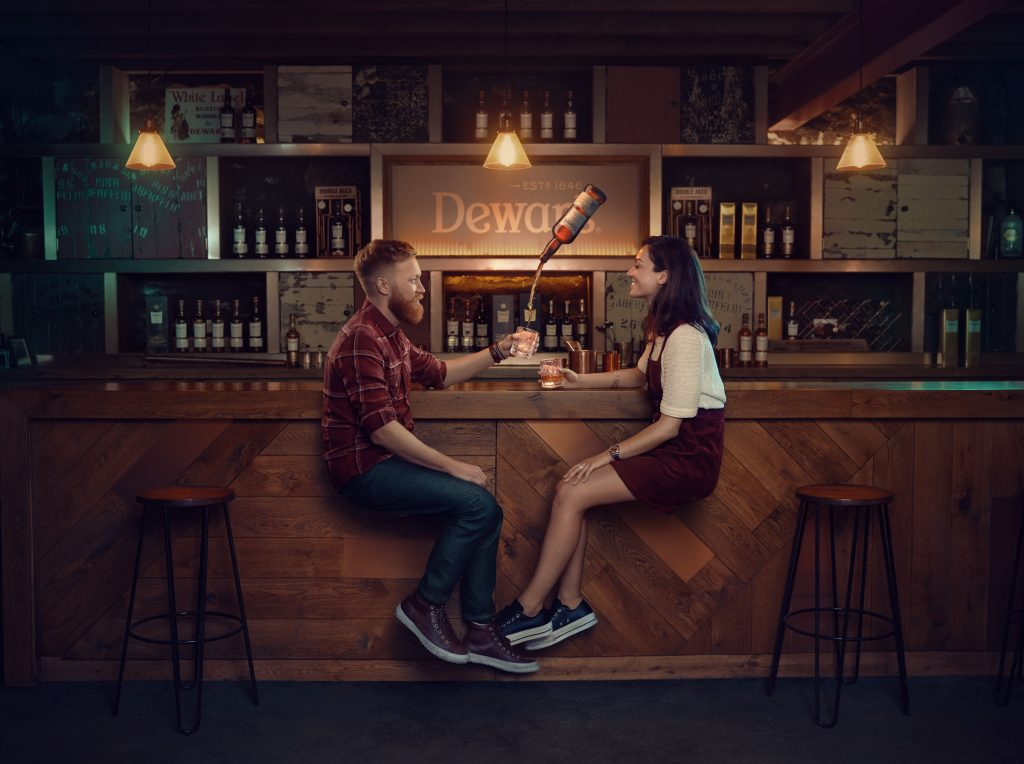 man and woman drinking at whiskey distillery photo by Todd Antony