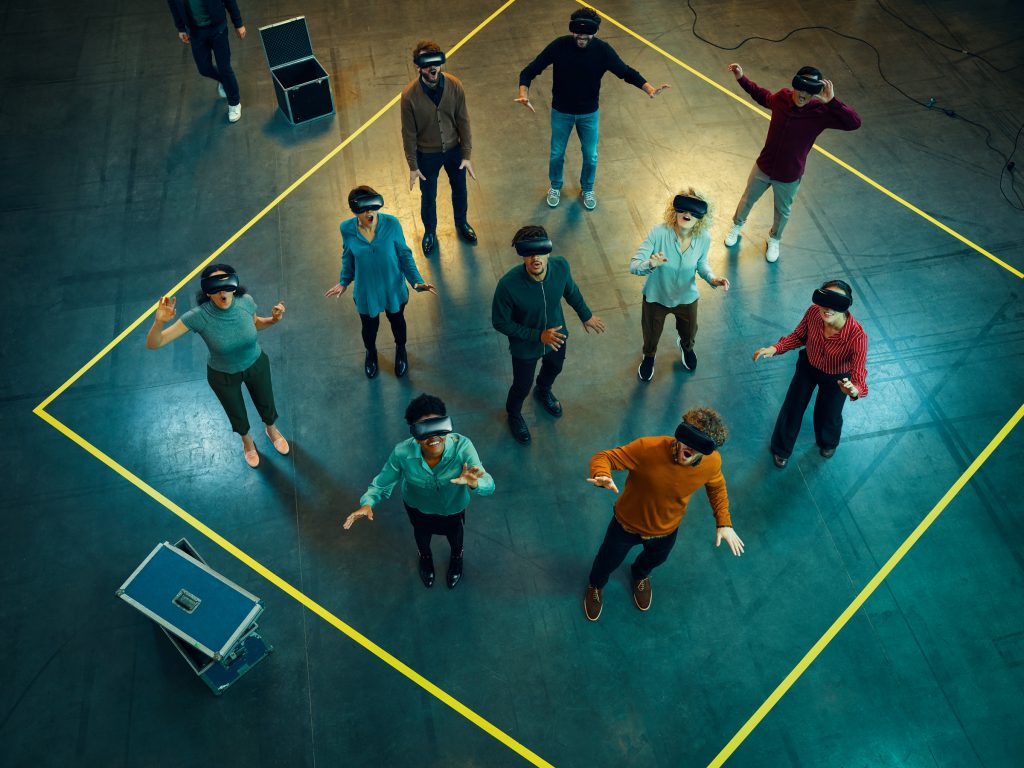 group of people using Virtual reality headsets photo by Todd Antony