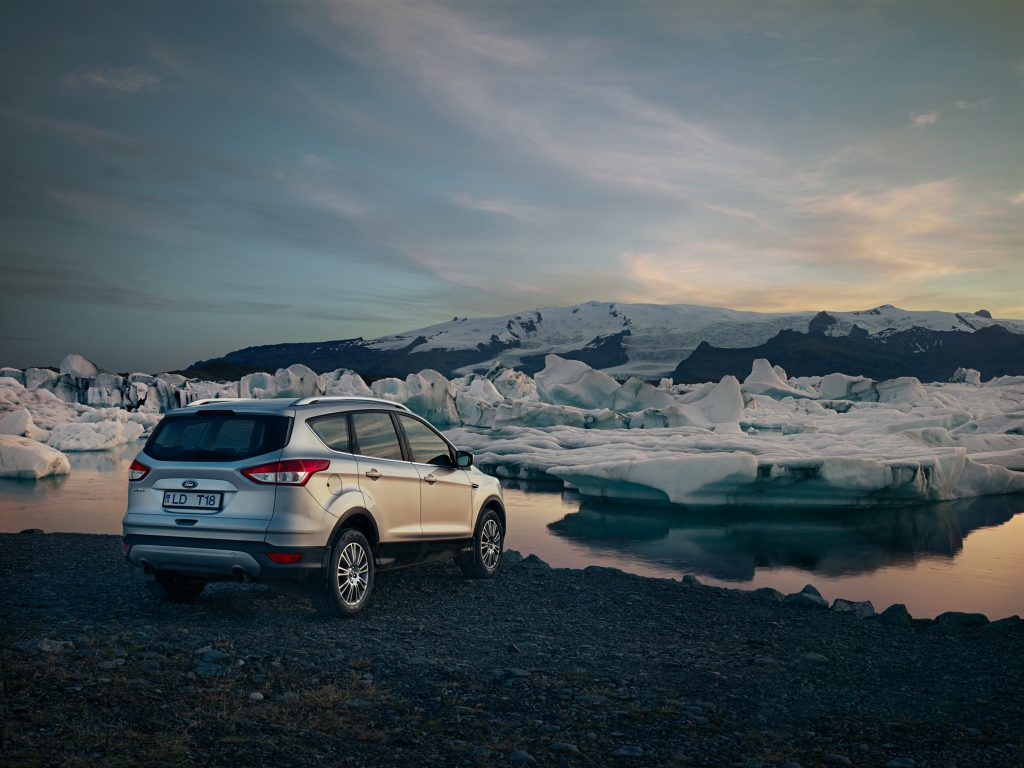 ford 4wd by icebergs in lake in iceland photo by Todd Antony