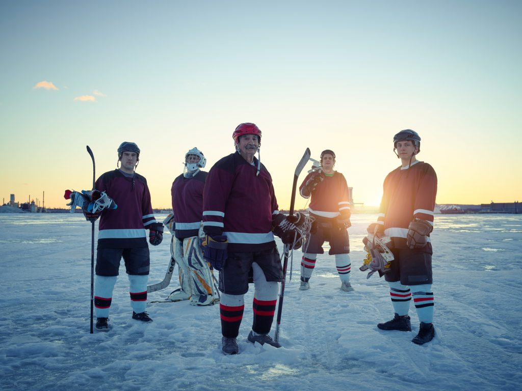 ice hockey players on frozen lake in Duluth photo by Todd Antony