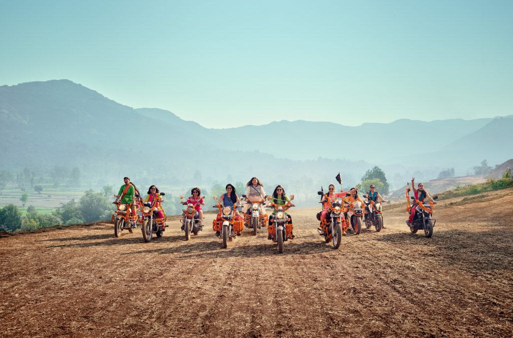 women riding motorbikes in India photo by Todd Antony