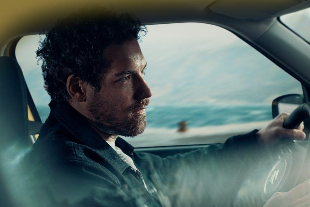 man driving in Suzuki car photo by Todd Antony