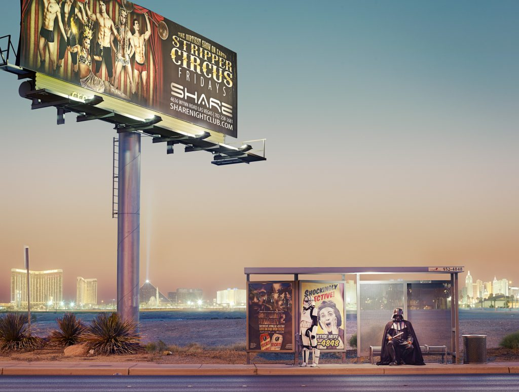 storm trooper and Darth Vader at bus stop in Las Vegas photo by Todd Antony