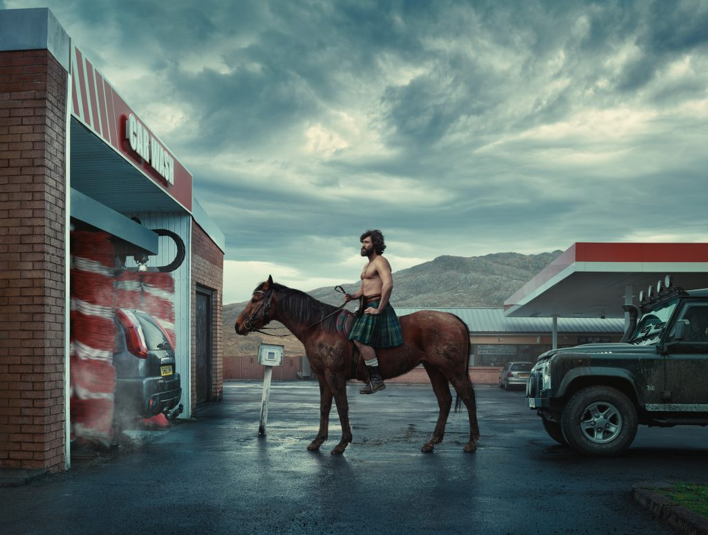 man on horse entering car wash in Scotland photo by Todd Antony